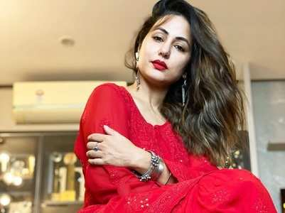 Hina decks up in a red suit for Eid