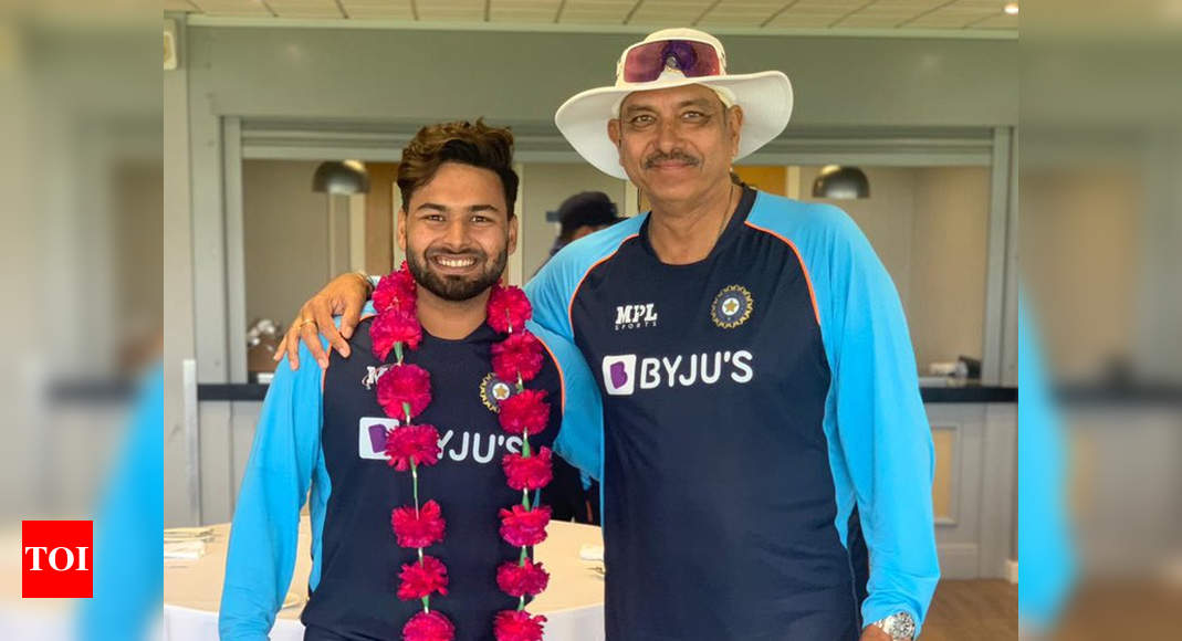 Garlanded Rishabh Pant thanks Ravi Shastri for grand welcome | Cricket News – Times of India