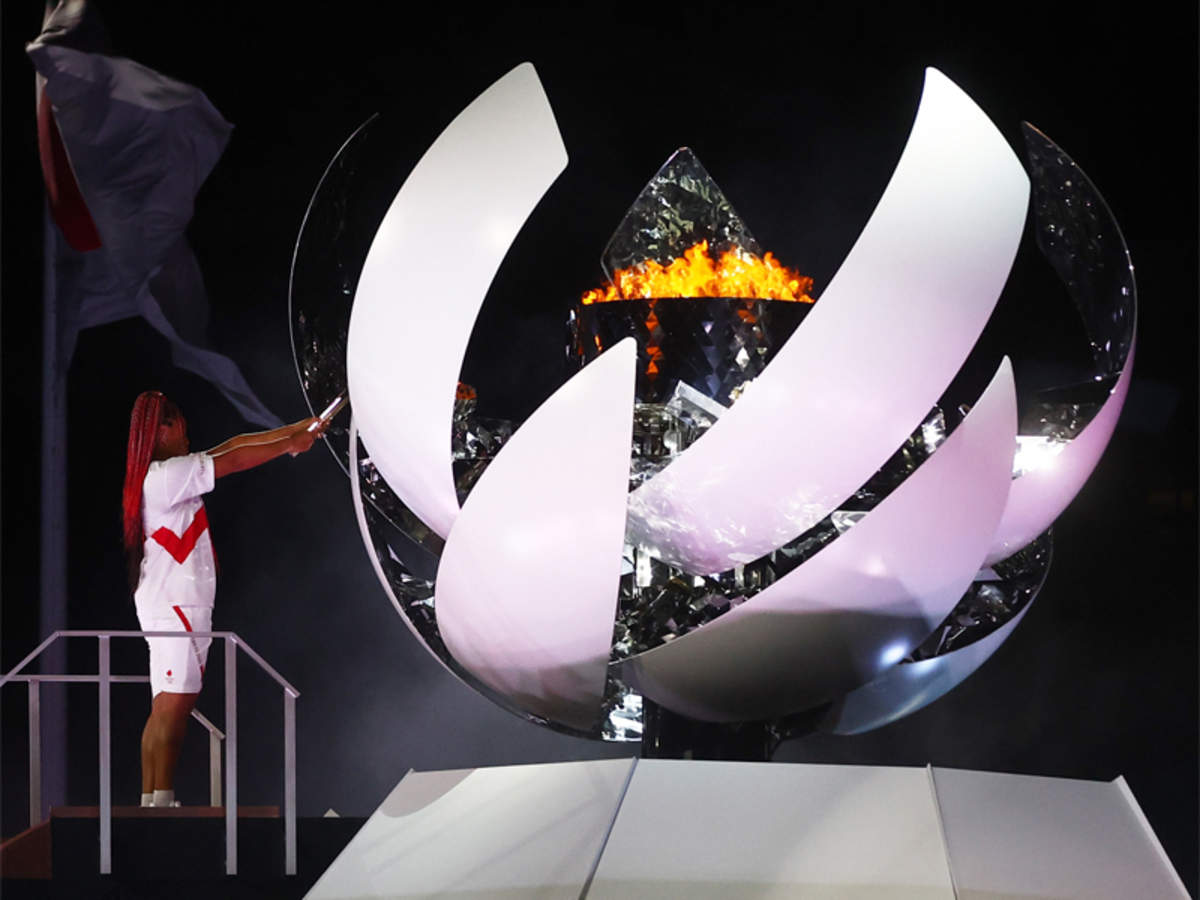 Tokyo Olympics 2020: Naomi Osaka lights flame as Tokyo's 'games of hope'  open | Tokyo Olympics News - Times of India