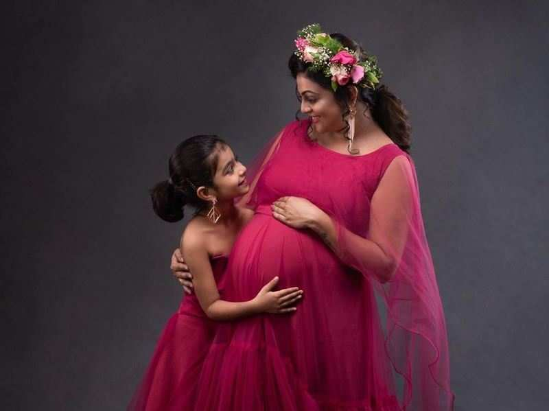 Mom-to-be Aswathy Sreekanth: My daughter once didn't want a sibling; she now wakes up kissing my baby bump