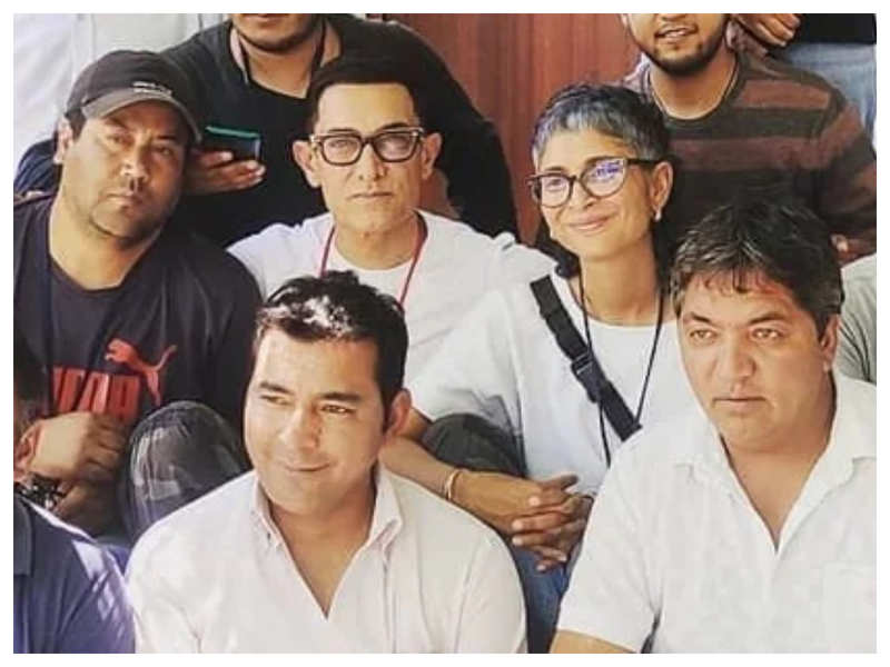 Aamir Khan and Kiran Rao pose with a group of people in Kargil on sets of 'Laal Singh Chaddha' in this new photo