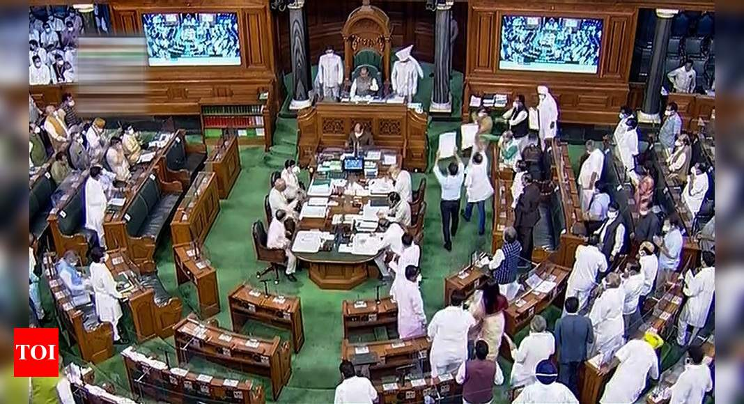 Unruly scenes in Lok Sabha; Congress MPs throw papers at Chair, treasury benches | India News – Times of India