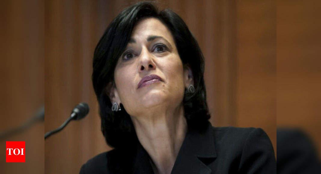 Masks, vaccination could halt surge, says CDC's Walensky