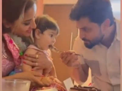 Monalisa's hubby cuts cake with BFF's son