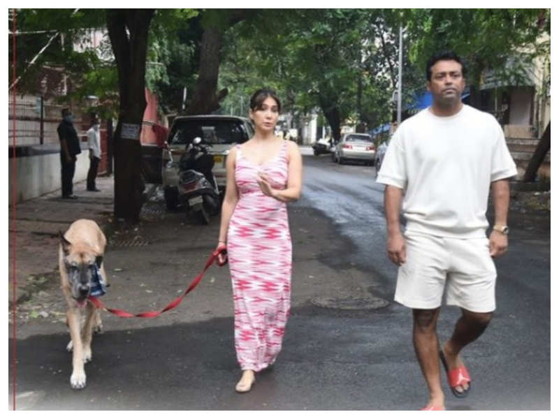 Kim Sharma gets snapped by the paparazzi as she takes her dog out for a walk with her rumoured boyfriend Leander Paes