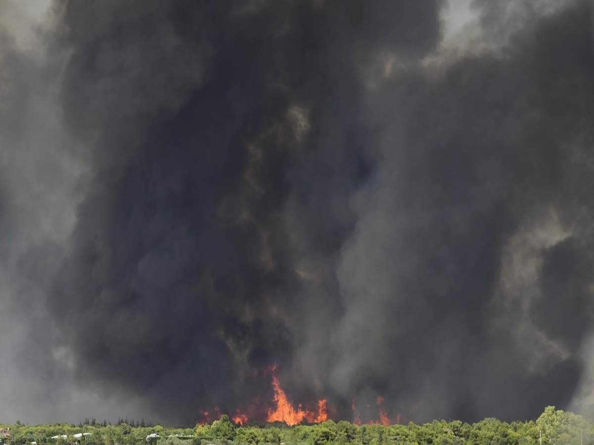 People Flee Homes as Wildfire Burns Near Athens Industrial Area