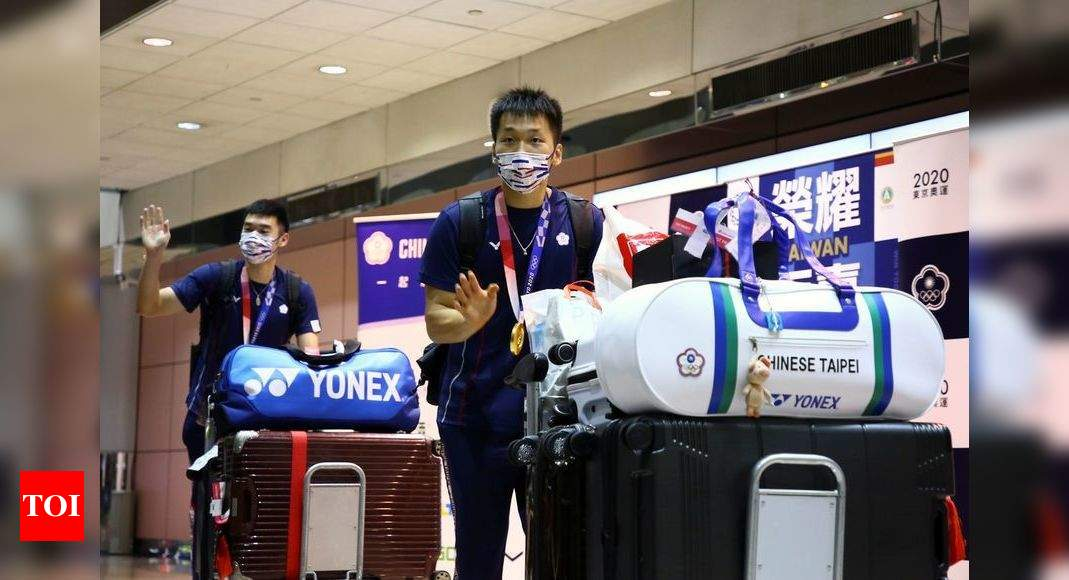 Tokyo Olympics: Taiwan welcomes Olympians home with fighter escort, pride in name - Times of India