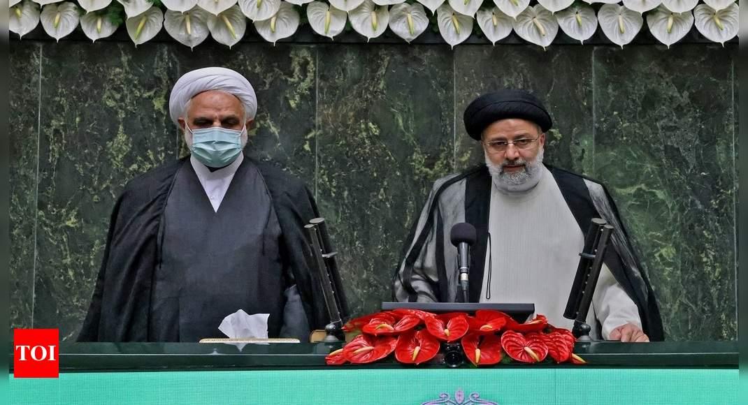 Ebrahim Raisi: Iran swears in new hard-line president amid regional tension | World News – Times of India