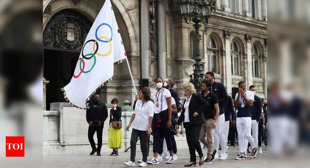 Flying the Olympic flag, Paris looks beyond COVID for 2024 Games   More sports News – Times of India