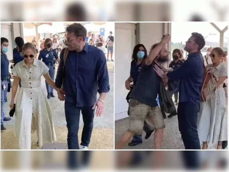 Ben Affleck pushes away a fan who attempts to click picture with Jennifer Lopez at the airport