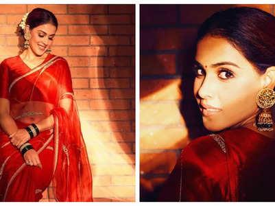 Genelia looks pretty in a ravishing red saree