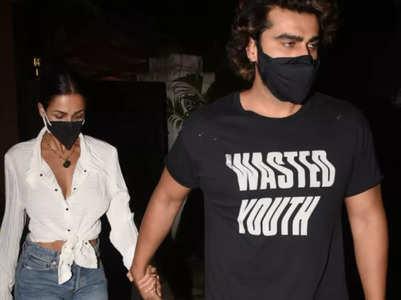 Malaika holds Arjun's hand on a dinner date