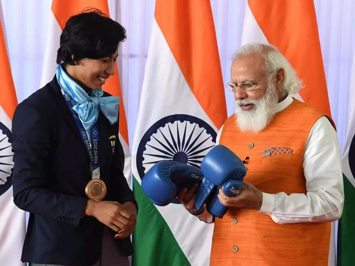 Lovlina Borgohain's gloves ahead of Neeraj Chopra's javelin as e-auction of Olympic  gifts to PM Narendra Modi begins   Off the field News - Times of India