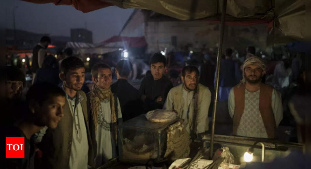 Thousands of Afghans flee to Iran as uncertainty grows under Taliban regime