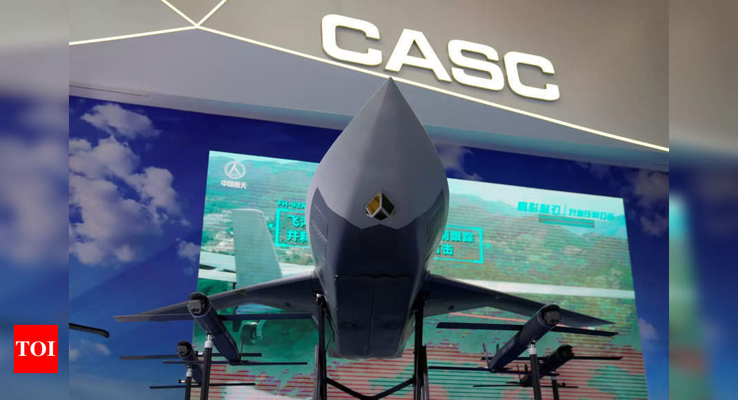 China unveils 'loyal wingman' armed drone concept thumbnail