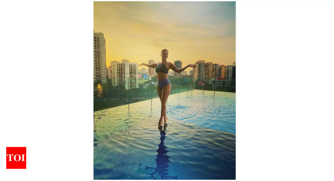 Sunny Leone takes a dip in her terrace pool