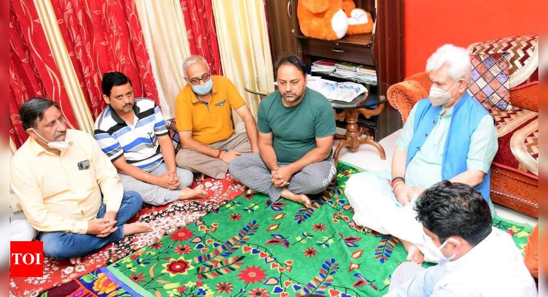 J&K LG Manoj Sinha visits family of slain teacher Deepak Chand, assures all support