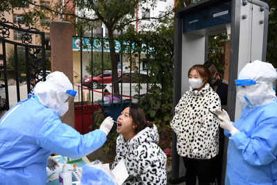 Hundreds of flights cancelled as China fights new Covid outbreak