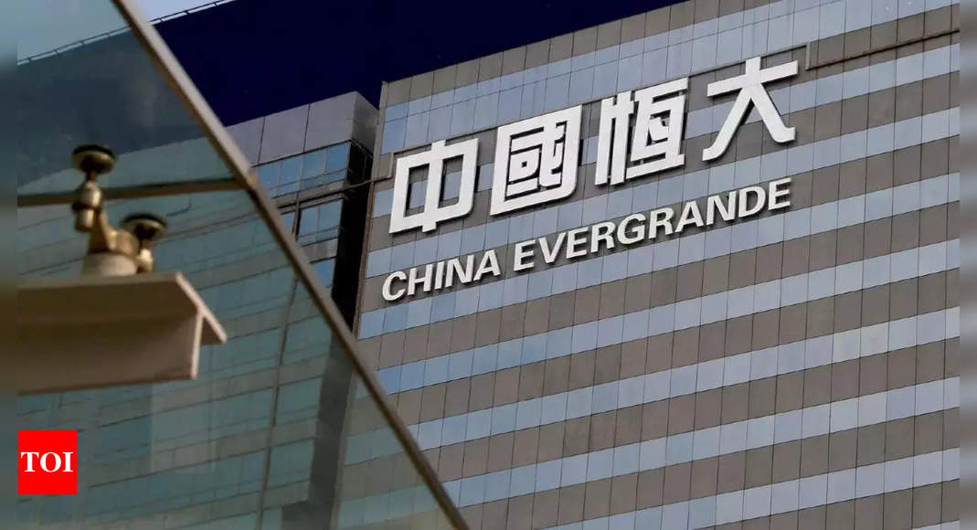 'China Evergrande lines up funds to pay interest, avert default'
