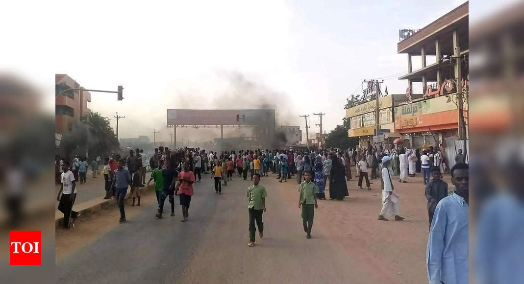 Sudan anti-coup protests defy army, PM held under guard