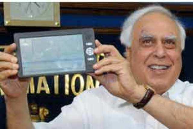 Kapil Sibal displaying Sakshat