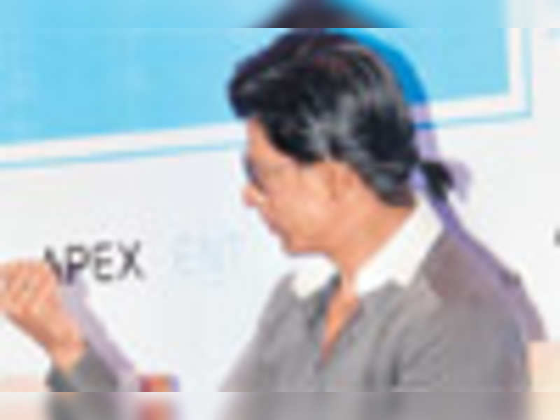 Check out Shah Rukh's pony tail