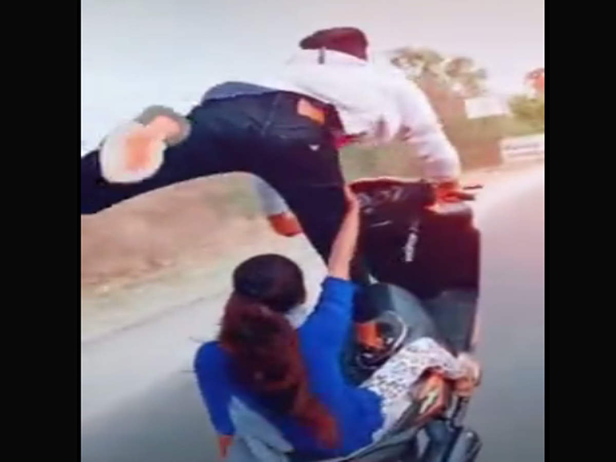 Image result for latest images of Bengaluru rider performing stunts with woman riding pillion held after video goes viral