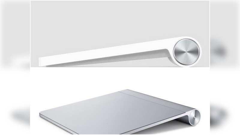 In looks: Xiaomi Mi Mini Router and Apple's Magic TrackPad.
