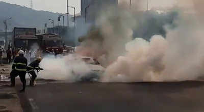 BMW car catches fire at Sion Panvel highway over LP flyover in Navi Mumbai