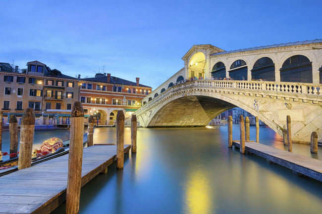 Stroll across the Rialto Bridge