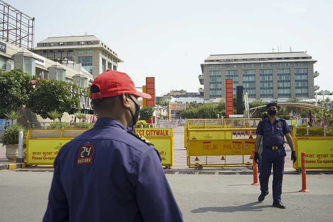 Security forces stand guard at public places